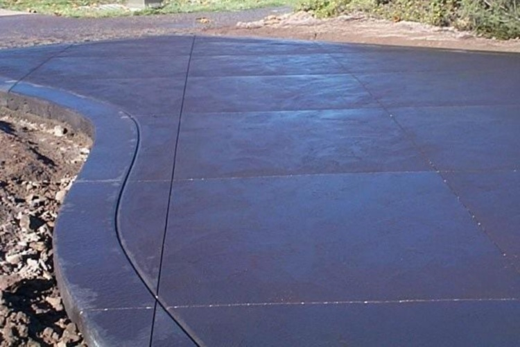 Black coloured driveway with saw cuts