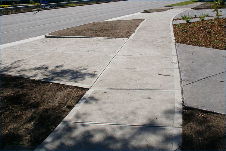 Concrete driveway and footpath photo commercial concreting with council approval.