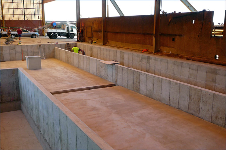 Commercial photo of concrete works including the laying of the main factory floor slab.