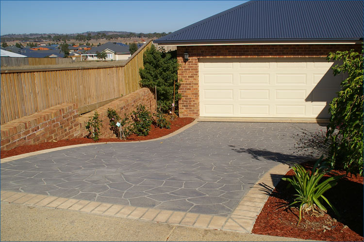 Residential photo of driveway stencile concrete techinque to create the look a stone driveway.
