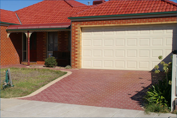 Photo of concrete stencile technique, used on coloured concrete to create a brick driveway look.